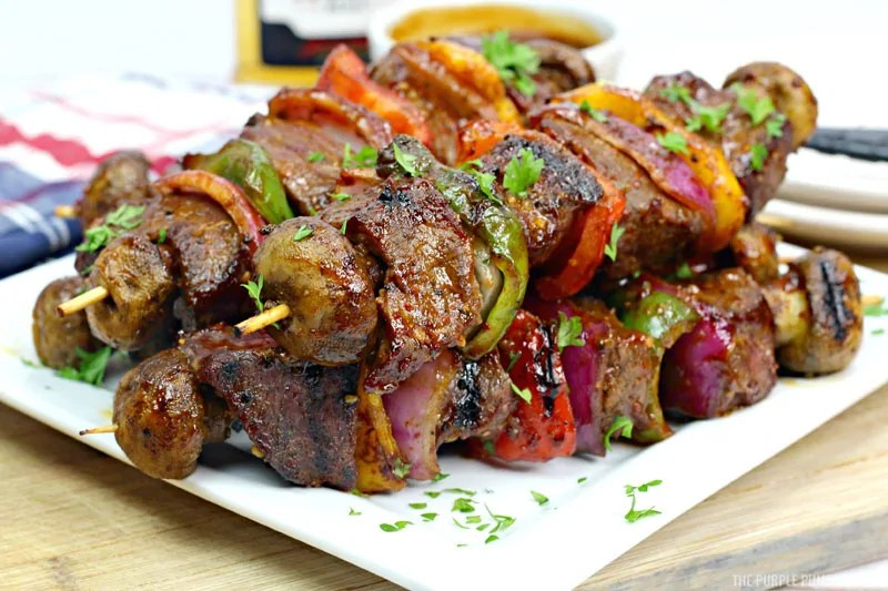 A plate of stacked steak kebabs