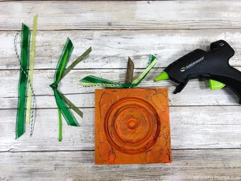 Attaching Green Ribbon to Wood Pumpkins