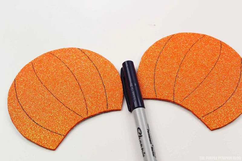 Drawing pumpkin lines on craft foam pieces