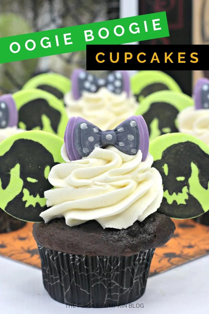 "Oogie Boogie Cupcakes - chocolate cupcake with white frosting, fondant ""Mickey Ears"" with Oogie Boogies face drawn on, and a purple and black spotted fondant bow on top."
