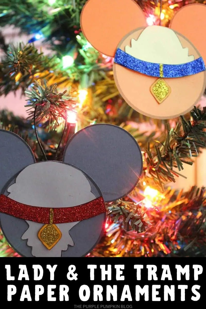 Lady and the tramp paper ornaments hanging on a Christmas tree