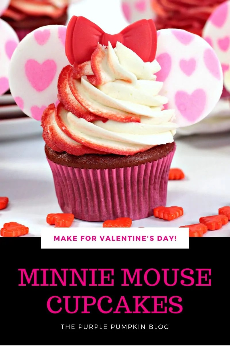 "Minnie Mouse Cupcakes for Valentine's Day. A single red velvet cupcake with a swirl of red and white frosting piped on top. White fondant ""ears"" are painted with pink hearts and inserted either side of the frosting with a red fondant bow on the top."