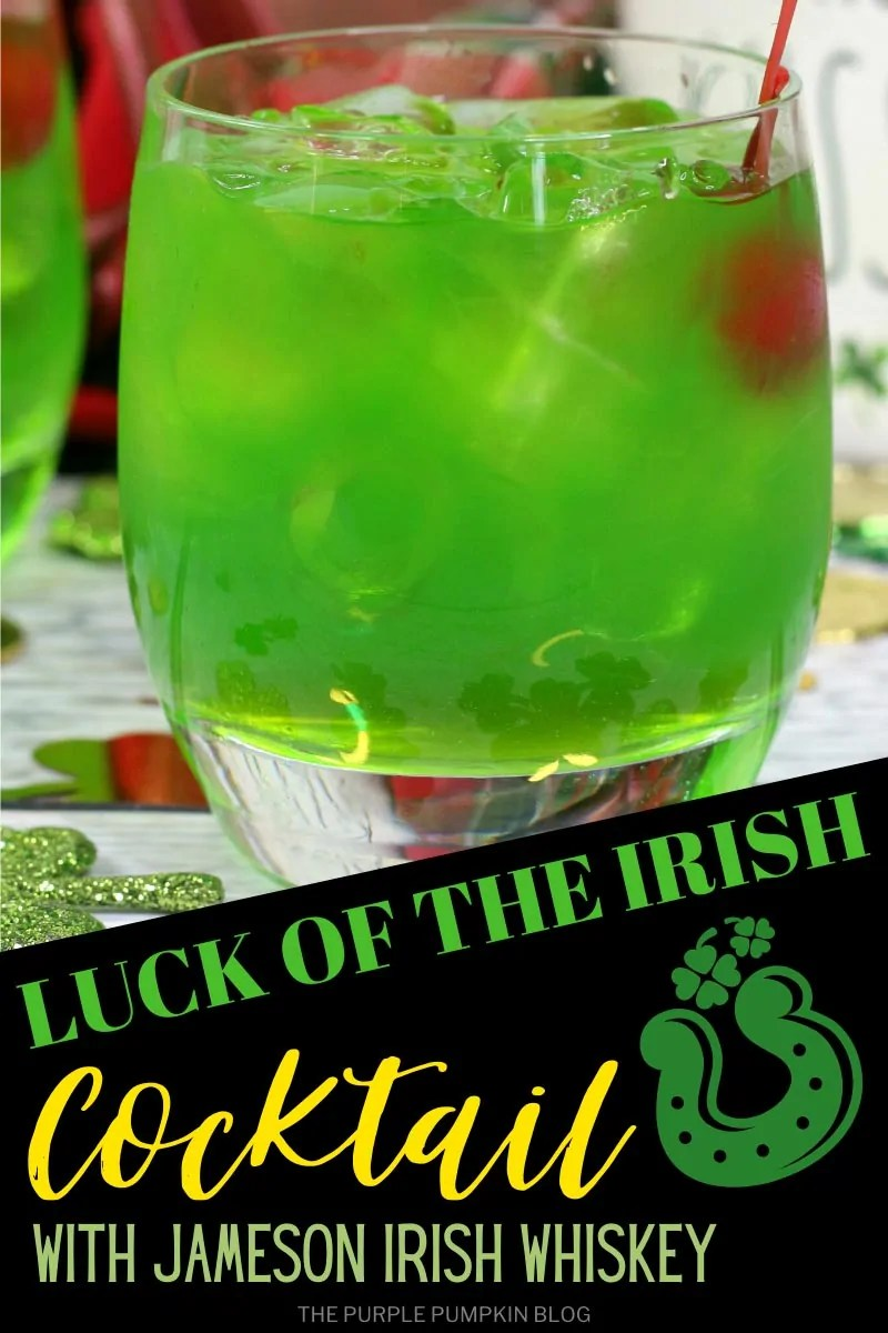 "Luck of the Irish Cocktail with Jameson Irish Whiskey A short round glass filled with green""Luck of the Irish"" cocktail and a red cherry floating in the drink. Glittery shamrock confetti surround the glass. Same drink pictured throughout this post from different angles and with different text overlay unless otherwise described."