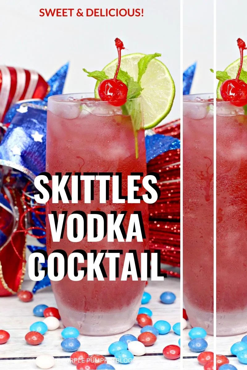 A glass filled with skittles vodka cocktail surrounded by M&Ms and 4th of July decorations.