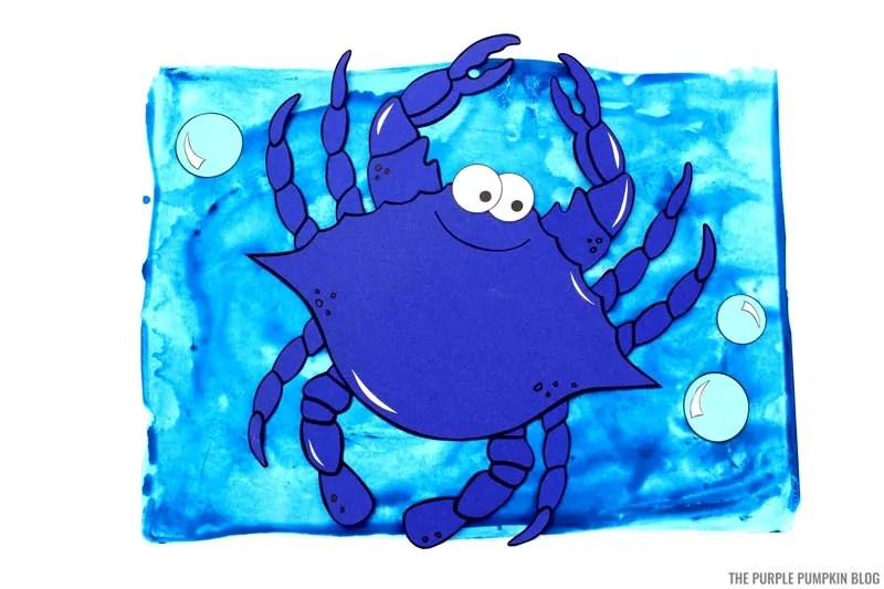 paper crab on painted ocean background