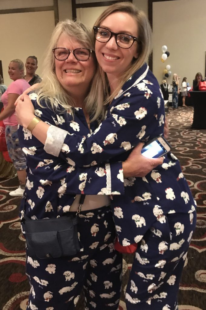 A mother and daughter wearing matching jammies!