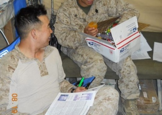 A picture of some of our young military Heros receiving one of the packages. Look at the delight on their faces, over something so simple!