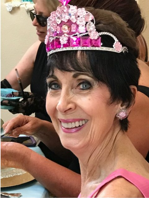 Miss Stella with her creative pink hand crafted tiara! Who could beat that smile?