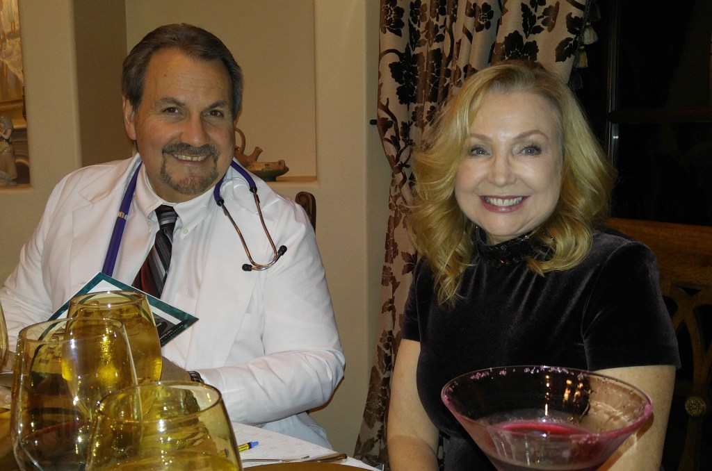 "Mike, as Dr. Malcolm ""Mal"" Praktiss and Olha, as Dame Allison Bigh. Funny thing is, Mike came practically screaming and kicking when he found out it was a Murder Mystery and he had to come in costume, but I think he had the most fun of all!"