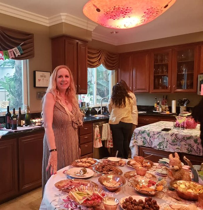 """The Queen"" Patti Phillips seems to be standing guard over the food table!"