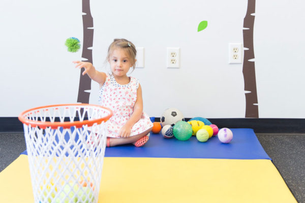 Pediatric Physical Therapy with Girl throwing ball