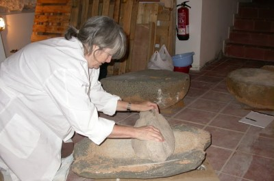 Grinding on a four thousand year old grindstone in the Museum in Minorca