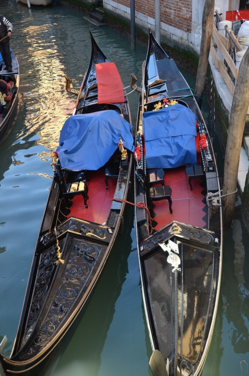 two gondolas with blue and red cover venice venezia travel italy