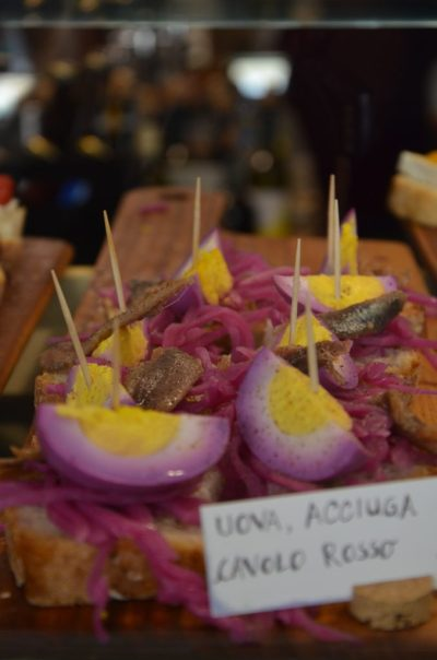 Cicchetti in Venice Venetian food. Eggs, anchovies and red cabbage.