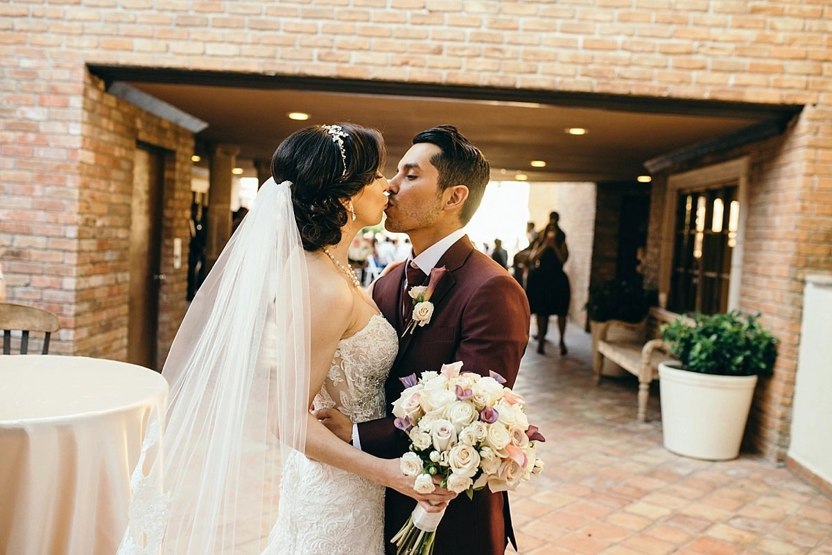 bride and groom kiss at the gallery houston