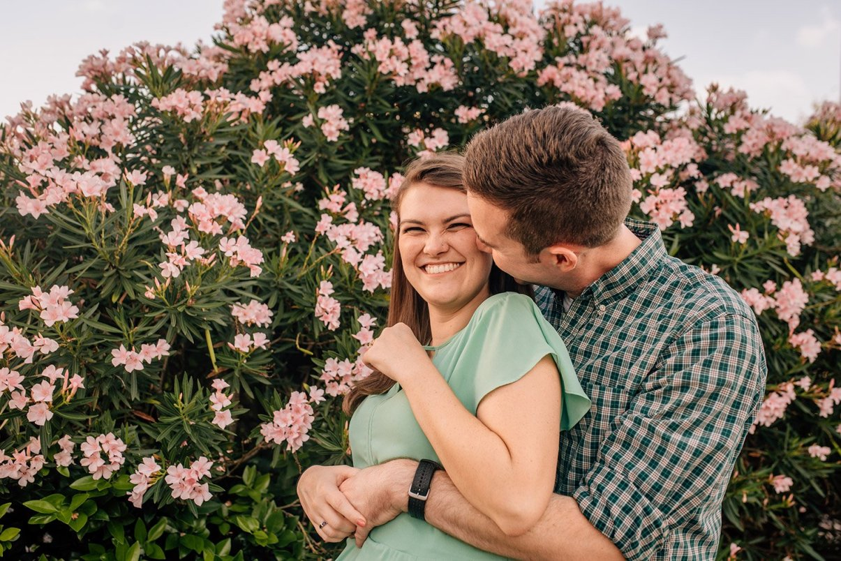 couple cuddling and laughing during engagement session