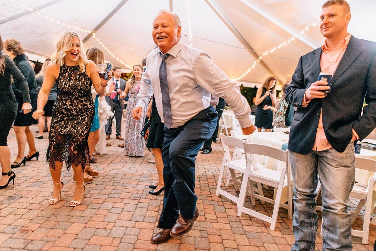 father of the bride celebrating
