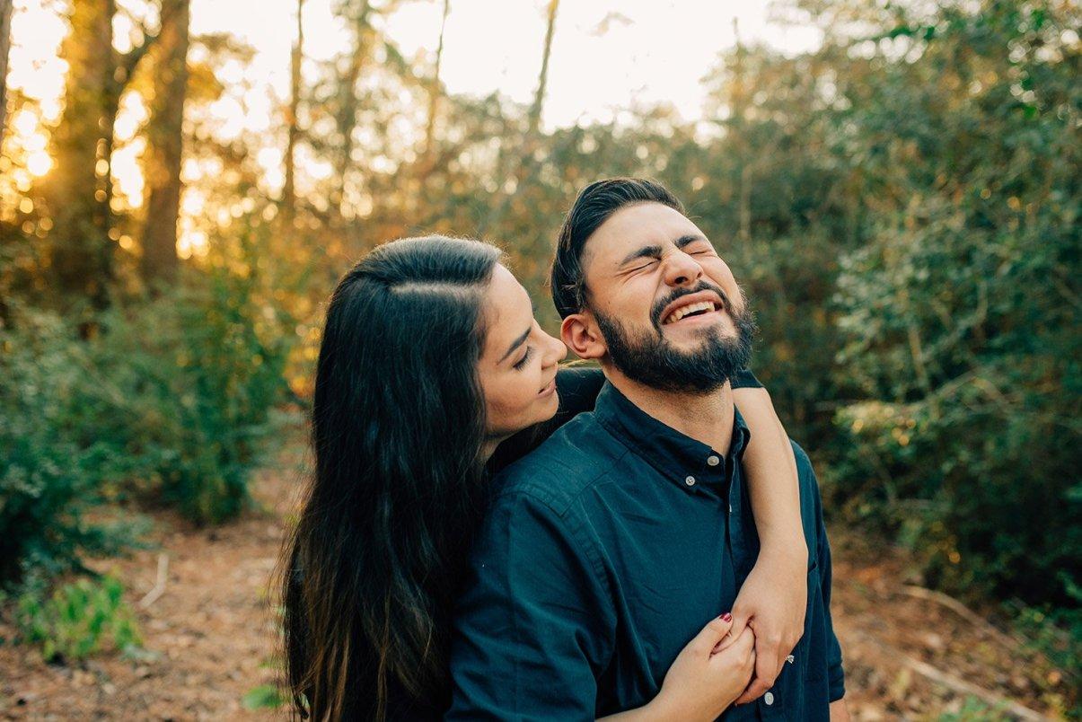 whispering something funny