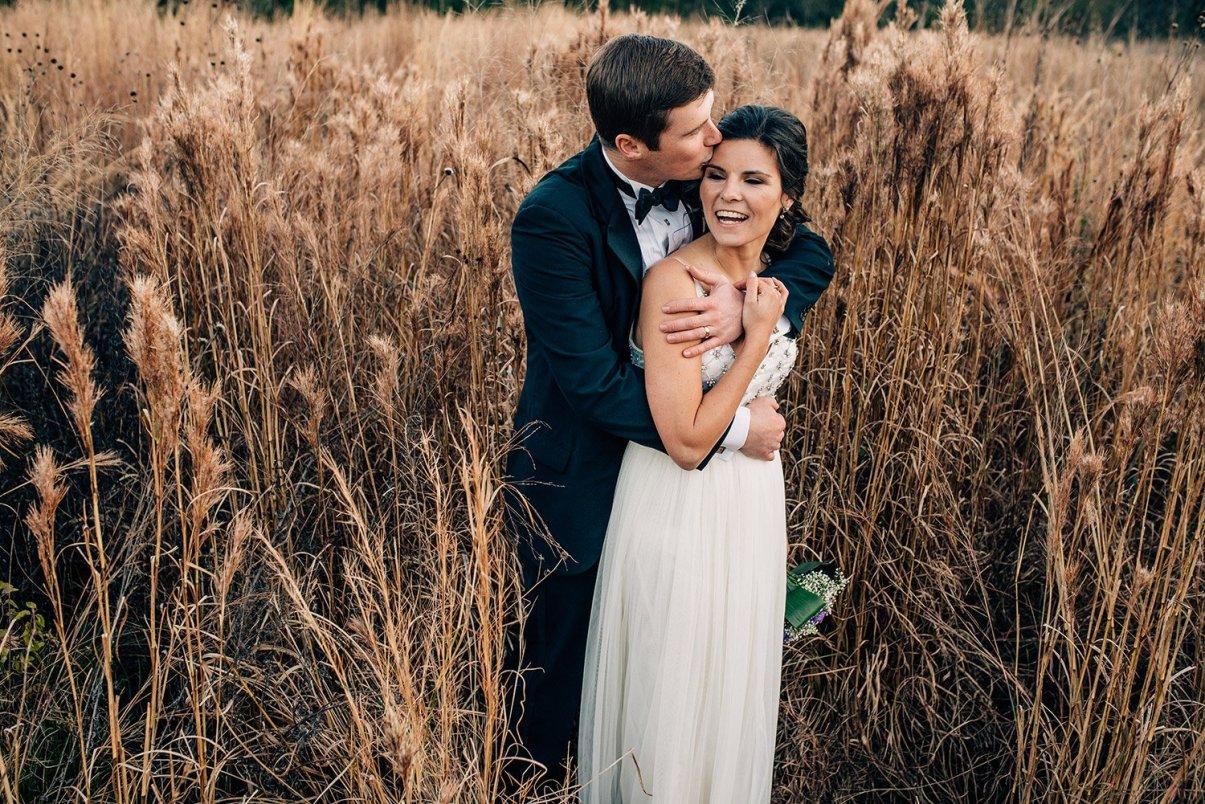husband kissing wife on forehead