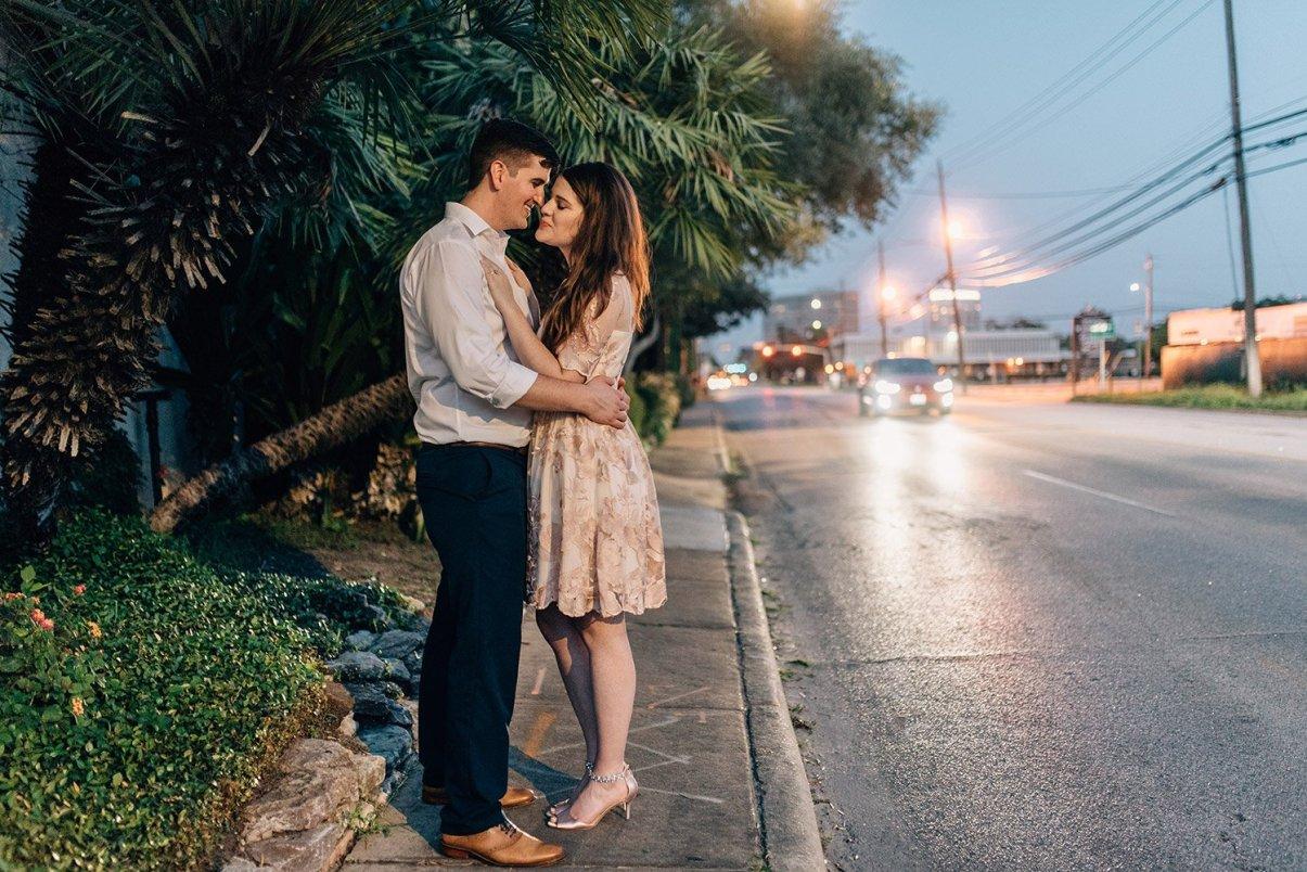 couple kissing on sidewalk