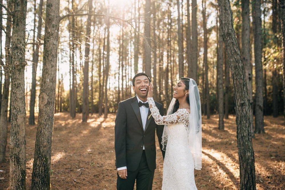 bride wiping lipstick off groom's cheek