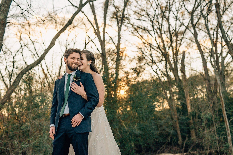 bride whispering in grooms ear