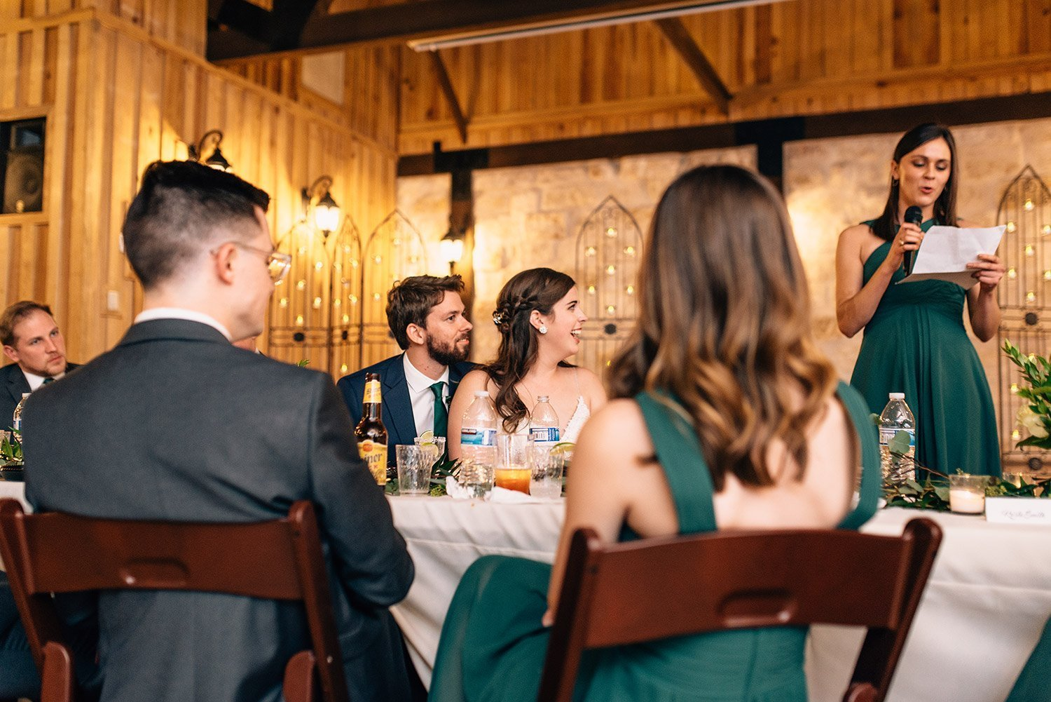 bride and groom watch maid of honor give a toast