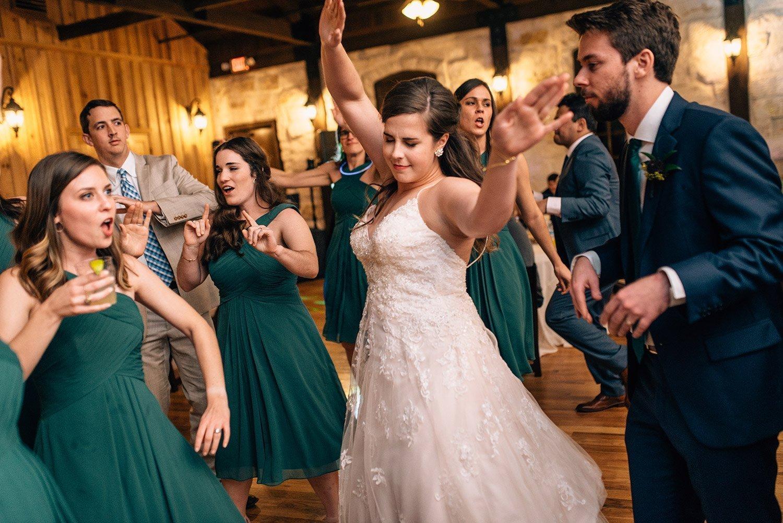 bride enjoying her wedding at the springs event center