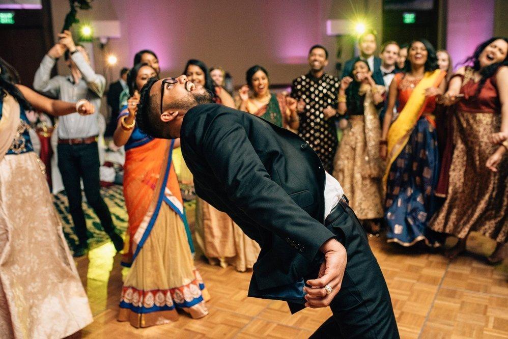 wedding MC doing the limbo