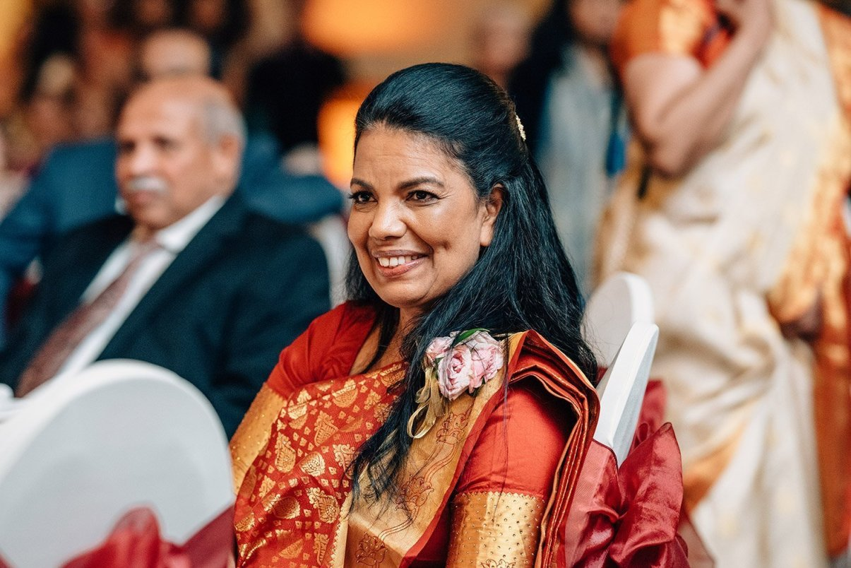 mother of groom watches dances at reception