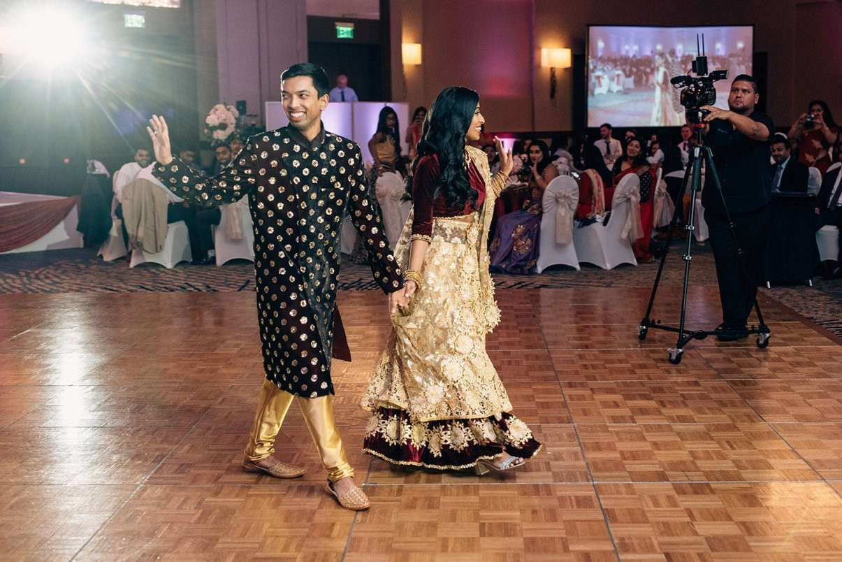 bride and groom enter in traditional Indian attire