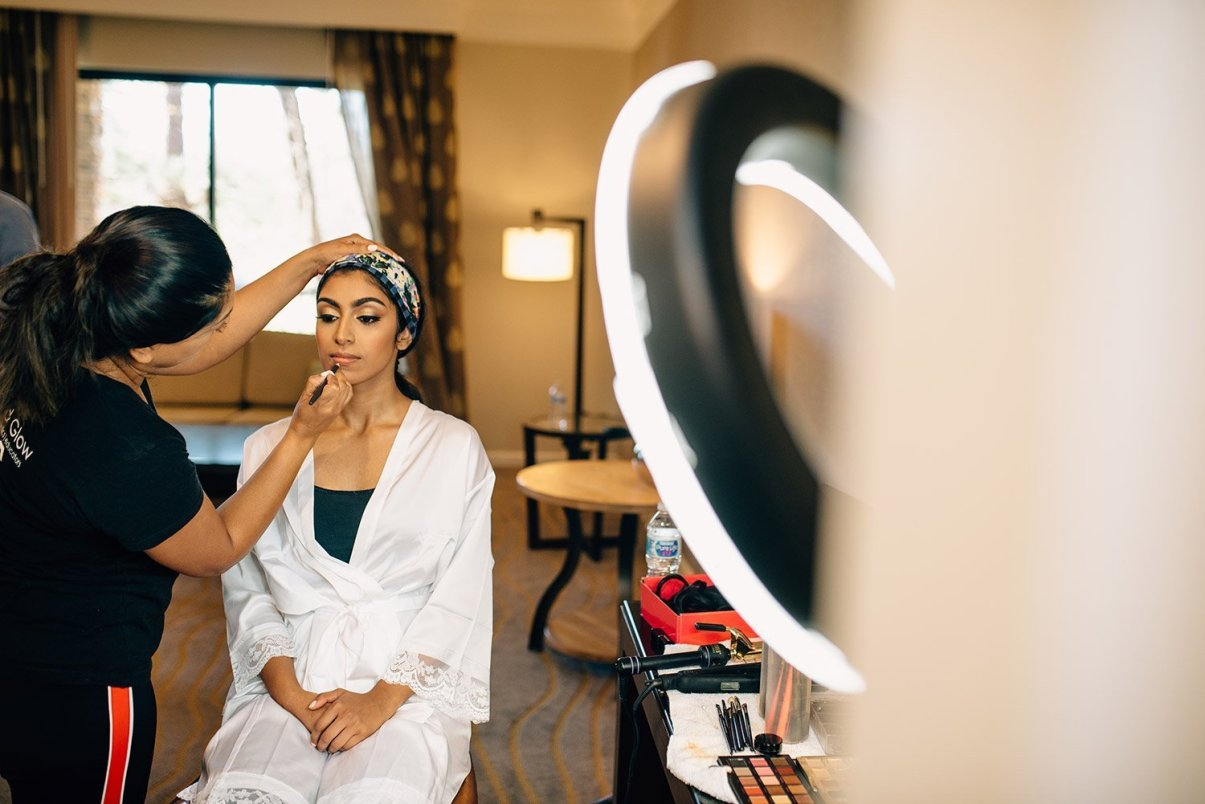bride getting her make up done before wedding