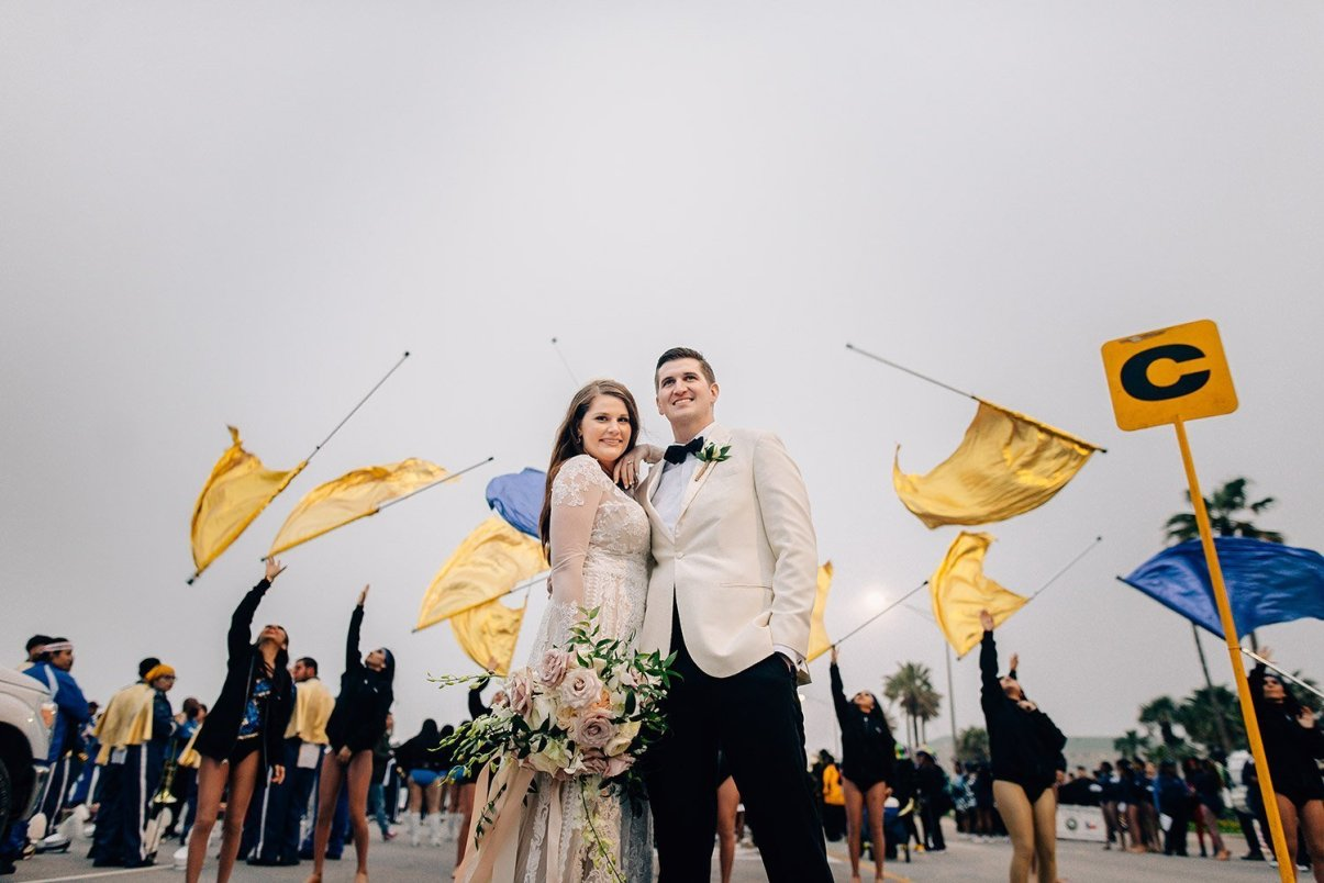 bride and groom with color guard on mardi gras