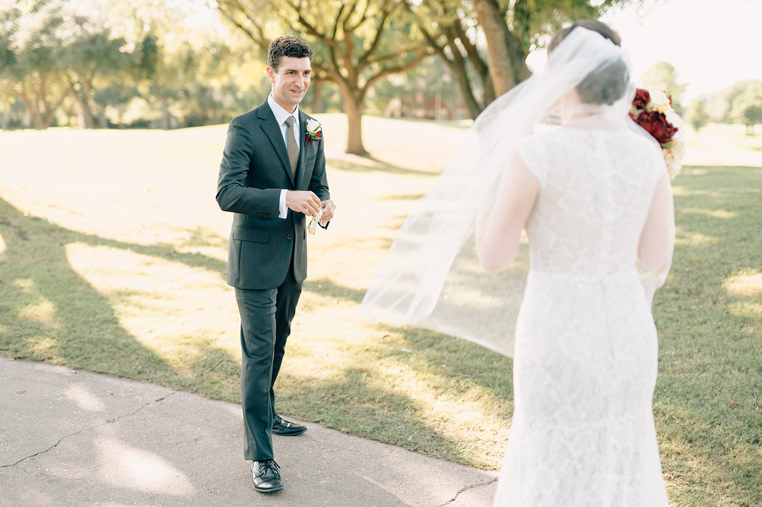groom sees bride for first time on golf course at sweetwater