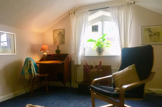 Therapy in Sheffield - Broomhill Room, Shows a tranquil therapy room with plants, a window and soft lighting
