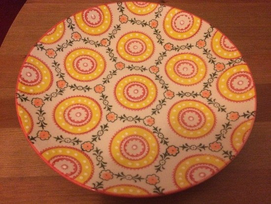 Plate covered in bright patterns