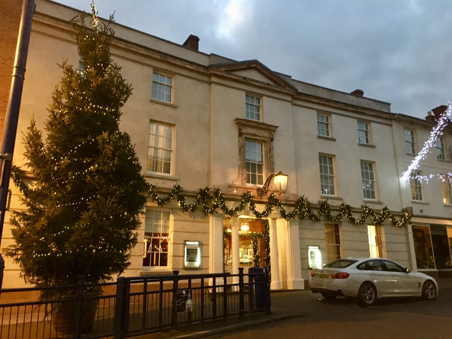 The front of the The Angel Hotel, Abergavenny, next to the Christmas tree