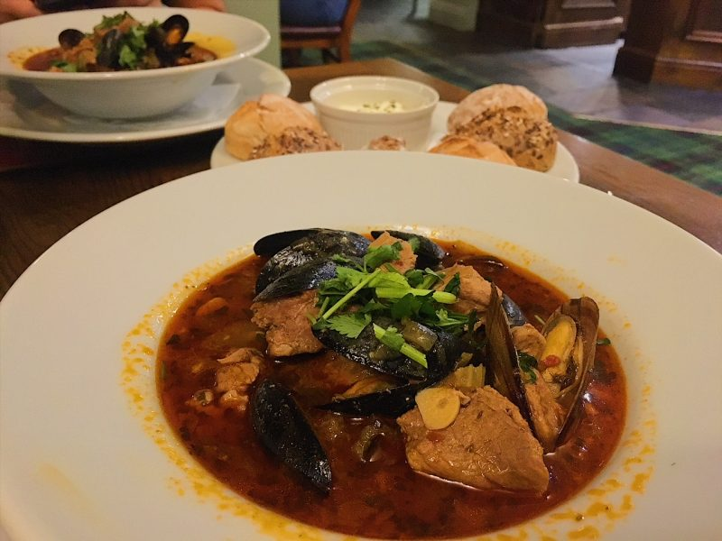 Braised pork and mussels in a rich hearty broth, with fresh bread and aioli