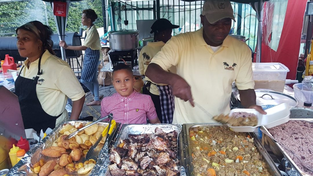 Jerk chicken and rice n' peas on sale on a stall at Notting Hill Carnival