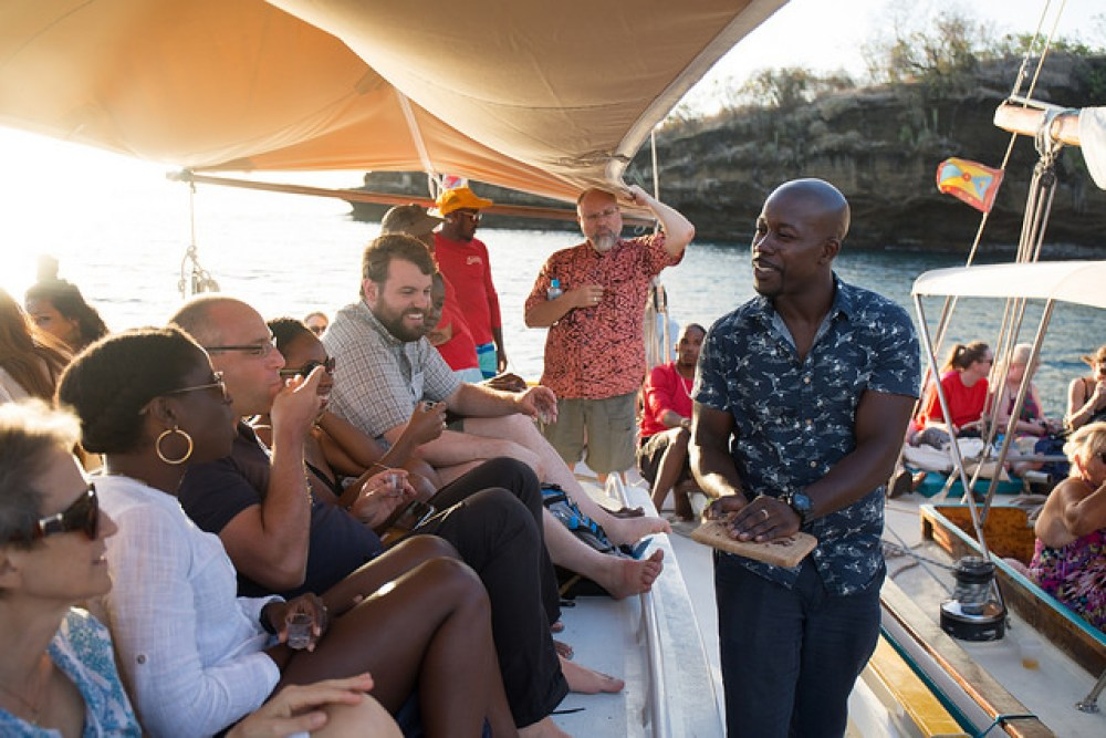 Aaron Sylvester handing out chocolate on a sunset cruise in Grenada