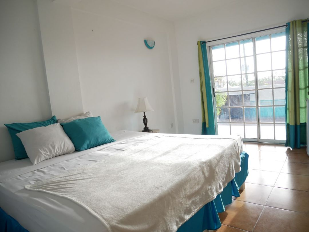 The bedroom in the Studio Lux apartment at SeaBreeze Grenada