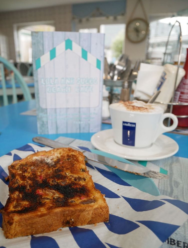 Toasted Welsh bara brith and cappucino at Lola and Suggs Beach Cafe in Talacre, north east Wales