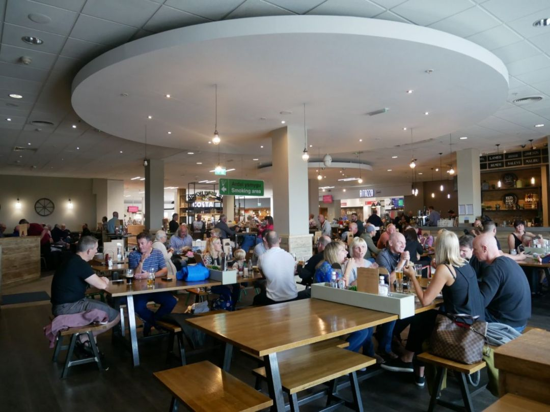 The Beer House at Cardiff Airport, bustling with guests