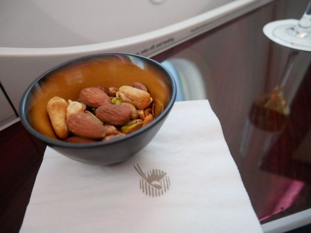 Warm nuts on-board Qatar Airways Business Class