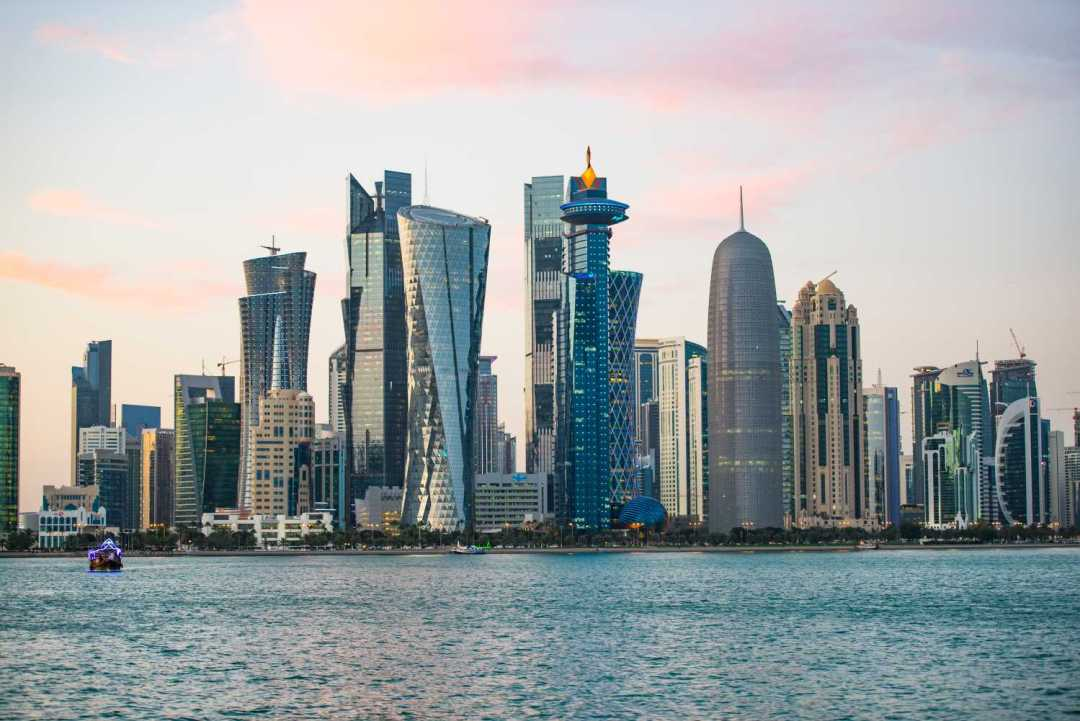 The city skyline in Doha, Qatar - skycrapers and high-rise office blocks. Would you know how to fit in with the Qatar dress code?