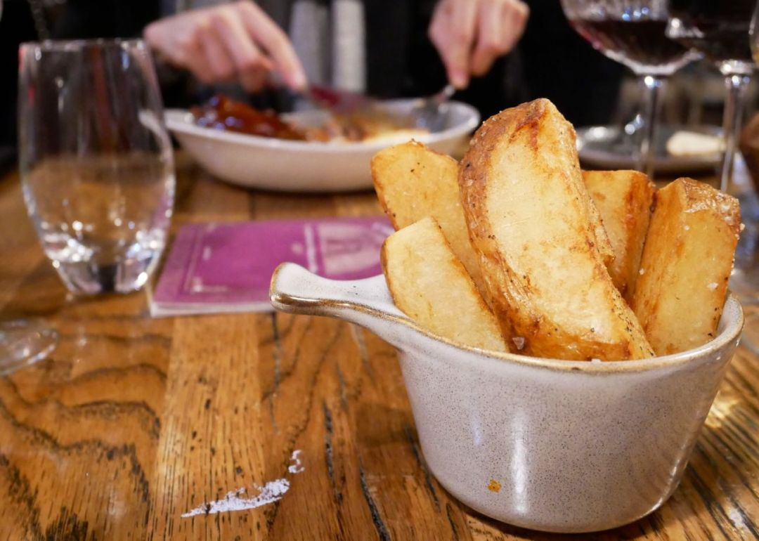 Thick cut chunky chips in a small bowl