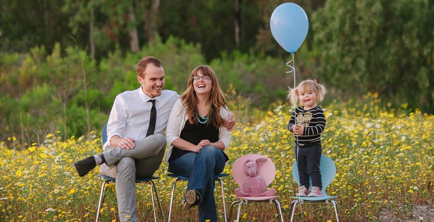 Amy and Paul Reams, their daughter Lucy, and a spot for their soon-to-be adopted kiddo