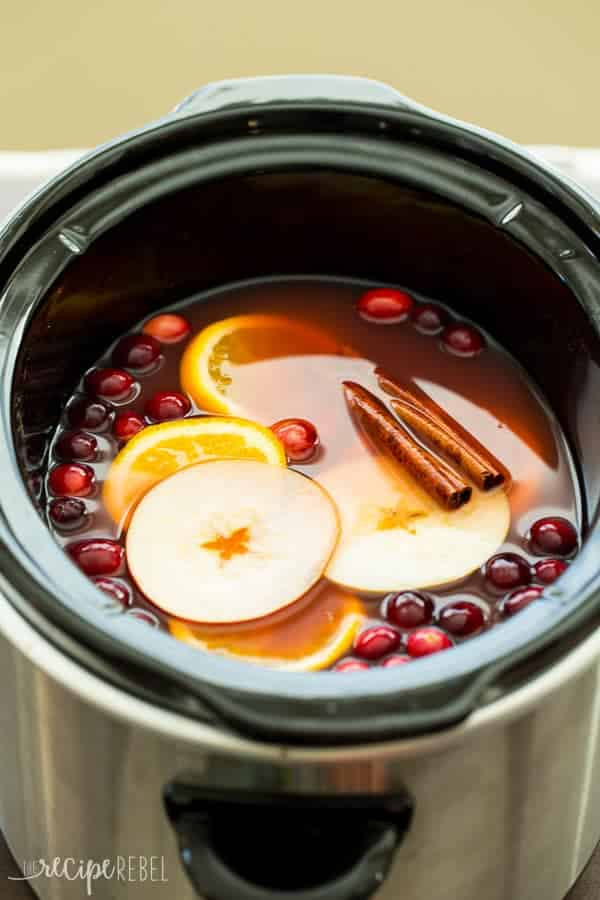 Slow Cooker Cranberry Apple Cider Recipe | The Recipe Rebel - The perfect holiday drink, this Slow Cooker Cranberry Apple Cider is made with apple, cranberry and orange juices! Perfect for your Thanksgiving or Christmas party.