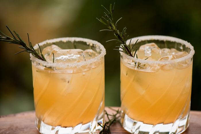 A deliciously refreshing winter cocktail containing sweet, juicy clementines, tangy lemon and aromatic rosemary simple syrup. Splash some vodka and enjoy! | The Recipe Wench