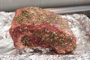Seasoned with garlic, thyme, oregano and rosemary, this Prime Rib Roast is EASY! Buy, beg or borrow a meat thermometer to prevent over-cooking. This roast is perfect for your holiday meal! | The Recipe Wench